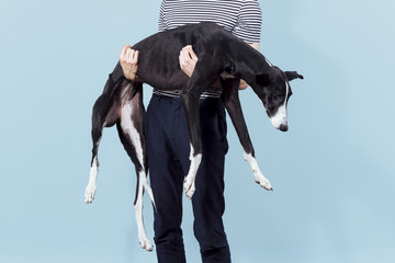 Man holding dog