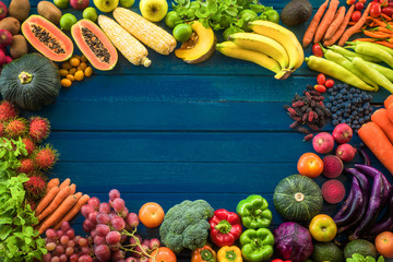 Top view of fresh fruits and vegetables organic on table, Frame of multicolour fresh fruits and vegetables with copy space on blue plank