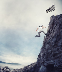 Reach the flag. Achievement business goal and difficult career concept