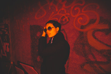 young androgyne woman walking on the night street