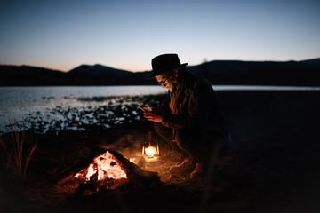 Man taking shot of bonfire