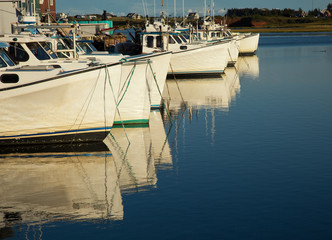Boats reflecting in water