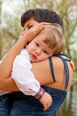 Tired kid lay down on his mother's shoulder