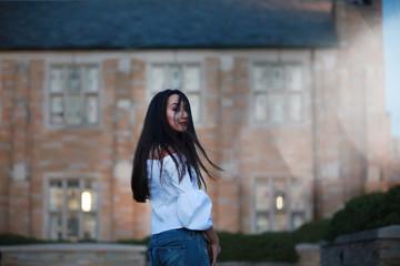 Stylish woman at mansion