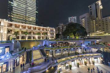 Old and modern buildings in Tsim Sha Tsui district, Hong Kong city at night