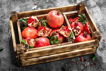 Ripe pomegranates in a box.