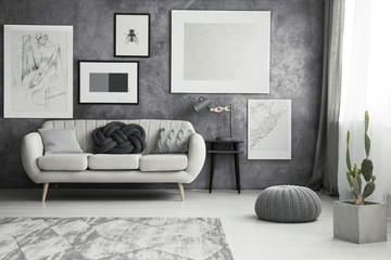 Living room with grey pouf