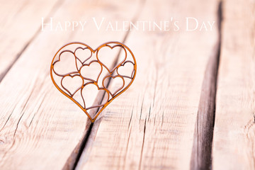 carved wooden heart on a wooden background