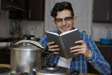 learning to cook with cookbook and pots