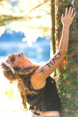 Pretty free hippie girl laughing. Peace. Body painting. - Vintage effect photo
