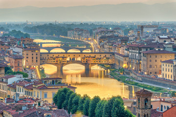 Florence sunset city skyline and Ponte Vecchio Bridge, Florence, Italy