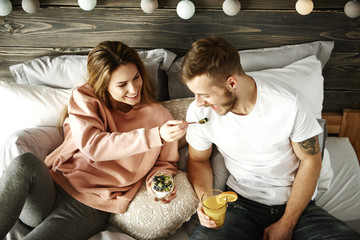 Woman sharing breakfast with man