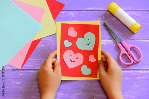 Child Is Holding A Valentines Day Card In His Hands Small Child