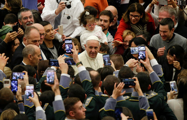 Pope Francis arrives to lead the general audience in Paul VI hall at the Vatican