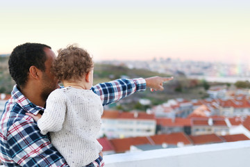 Father and son looking at the landscape from the terrace