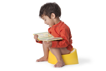 Toddler boy sitting on a potty
