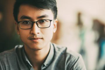 Fototapeta Confident Asian businessman in eyeglasses obraz