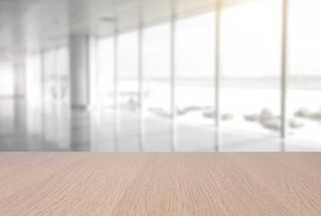 top empty wood table on blurred abstract hallway background. can be used for display or montage your product.
