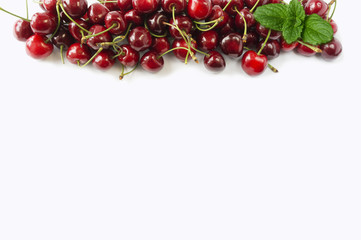 Sweet cherry berries on white background cutout. Cherry fruit at border of image with copy space for text. Background berries. Various fresh summer berries isolated on a white. Top view.