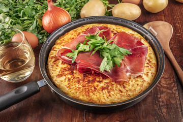 A closeup photo of a Spanish tortilla with ingredients