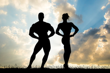 couple of bodybuilder at sunset