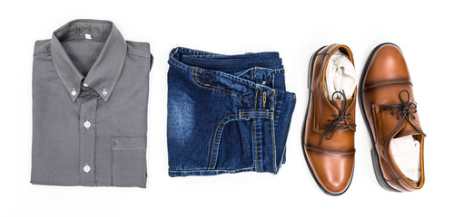 Top view men apparel, grey shirt, blue jean, leather shoes brown.