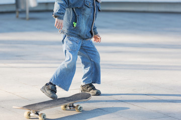 happy children skateboarding on fresh air, healthy lifestyle