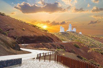 Beautiful panorama over Astronomical Observatory of Izana in Teide mountain illuminated by sunset light in Tenerife, Canary island of Spain
