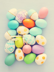 Top view of easter colorful eggs over blue background.