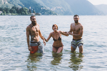 Portrait of three young adult friends in lake Como, Como, Lombardy, Italy