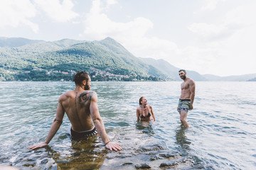 Three young adult friends in lake Como, Como, Lombardy, Italy