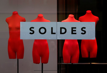 """A banner reading """"Sales"""" is seen on a clothing store's front window during the start of winter sales in Strasbourg"""