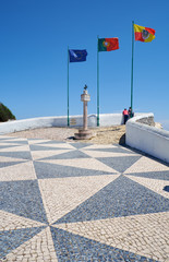 Flags of European Union, Portugal and Nazare at Miradouro do Suberco view point. Nazare. Portugal.