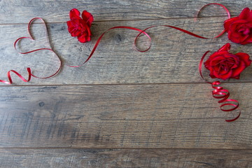 Valentines day background with red roses and ribbon. Valentine's day table place setting
