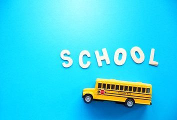 school bus toy on blue background