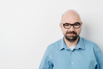 Studio shot portrait of a man looking at camera