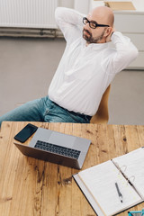 High-angle view of a businessman relaxing at desk