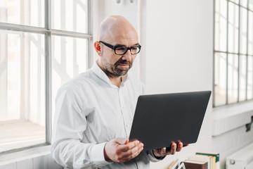Businessman using a handheld laptop