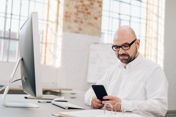 Businessman using a mobile phone at desk