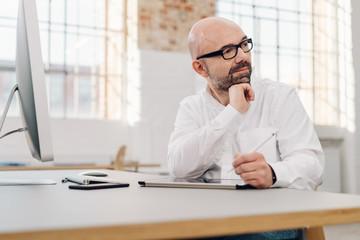 Businessman sitting watching something