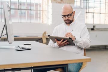 Businessman working on a handheld tablet