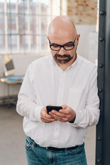 Businessman reading a message on his cellphone