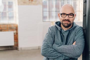Portrait of middle-aged man wearing sweatshirt