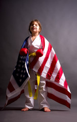 Girl karate yellow belt with US flag winner of competition