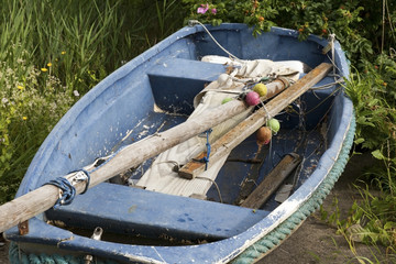 Blue Rowing Boat With Oars