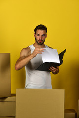 Delivery and moving in concept: macho checking on documents