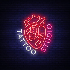 Tattoo studio logo, neon sign, symbol of human heart, bright billboards, night banner, neon bright advertising on tattoos, for tattoo salon, studio. Vector illustration for your projects
