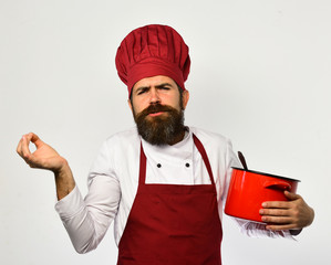 Chef holds soup or compote making italian gestures