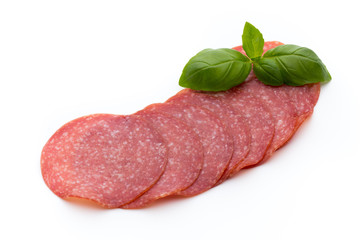 Salami slices isolated on white background.