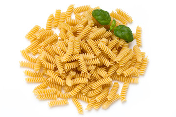 Uncooked fusilli pasta isolated white background.